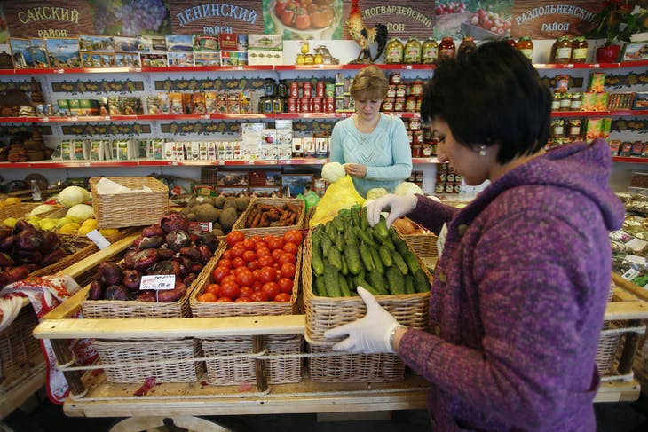 Employees place and sort vegetables at Crimean Farmstead, Russia's first specialized grocery which sells products from Crimea, in the Moscow suburb of Khimki