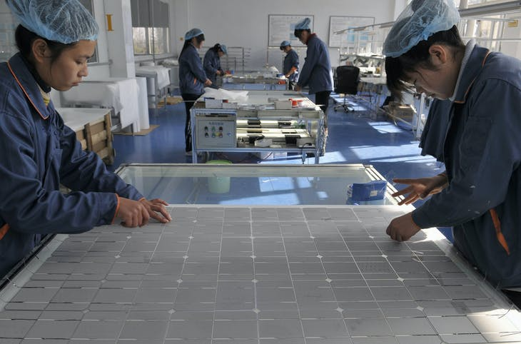 Employees work at the solar cells production line of the Blue Carbon Technology Inc. in Rizhao, Shandong province December 3, 2010. China is considering investments of up to $1.5 trillion over five years in seven strategic industries, sources said, a plan aimed at accelerating the country's transition from the world's supplier of cheap goods to a leading purveyor of high-value technologies. The targeted sectors include alternative energy, biotechnology, new-generation information technology, high-end equipment manufacturing, advanced materials, alternative-fuel cars and energy-saving and environmentally friendly technologies. REUTERS/Stringer (CHINA - Tags: ENERGY ENVIRONMENT BUSINESS) CHINA OUT. NO COMMERCIAL OR EDITORIAL SALES IN CHINA - GM1E6C31AZG01